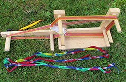 Three tie-dyed warps for inkle weaving