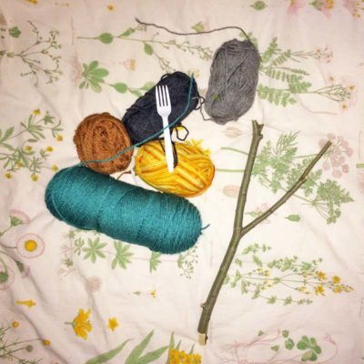 All I needed to create my woven branch: several balls of yarn, a branch, a fork, and scissors.