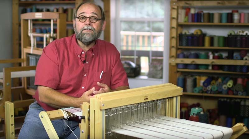 """Tom Knisely in <em><a href=""""https://shop.longthreadmedia.com/products/learn-to-weave-making-good-cloth-multi-shaft-loom-video-download"""" target=""""_blank"""">Learn to Weave</a></em>"""