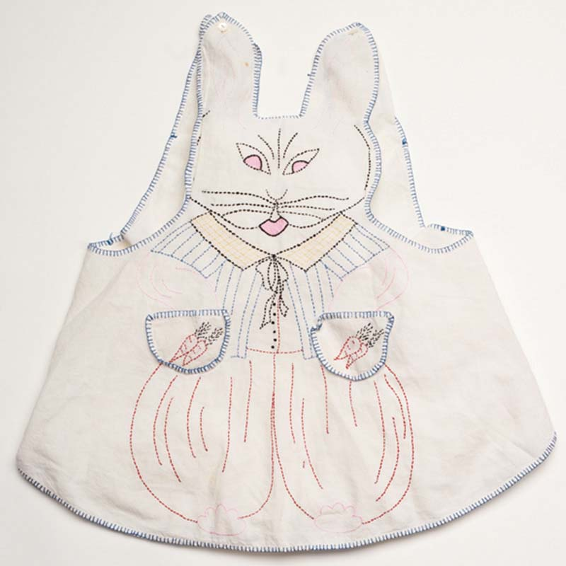 Child's bunny-shaped apron. Maker unknown. Cotton thread on cotton. Origin unknown. 1950s. Photo by Joe Coca.