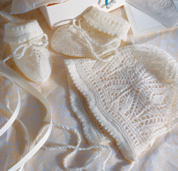 Free knitted lace bonnet and booties pattern to knit using shetland-style lace!