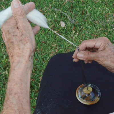 Catch a few fibers, turn the tahkli spindle, and draw back. Photos by Judy Ihrig
