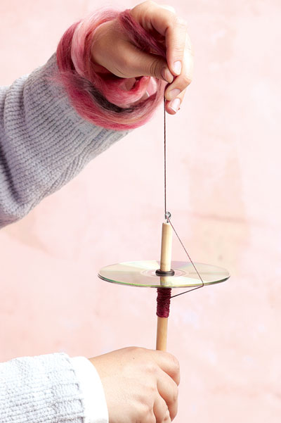 A DIY drop spindle made from a CD is an easy, portable, and inexpensive way to get a new spinner started.